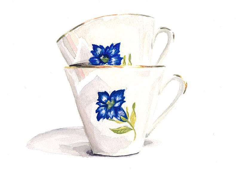 Zwei gestapelte Kaffeetassen mit Blumenmotiv