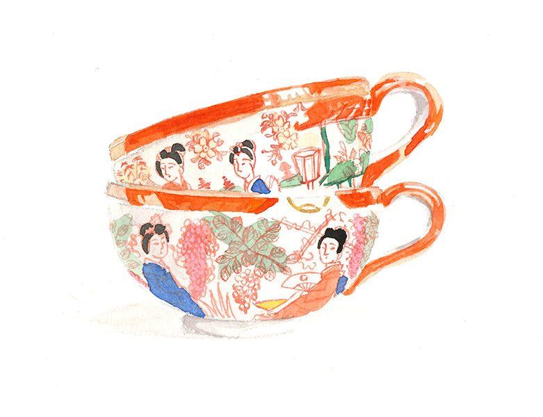 Zwei gestapelte Teetassen, bemalt
